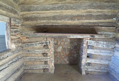 Fireplace inside Symbolic Cabin located in Memorial Building
