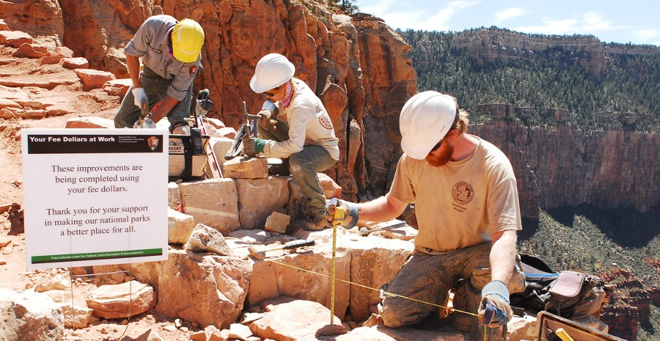 Three men working on a trail at the Grand Canyon