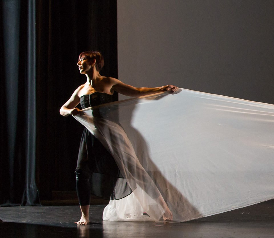 Dancer on stage in dramatic lighting