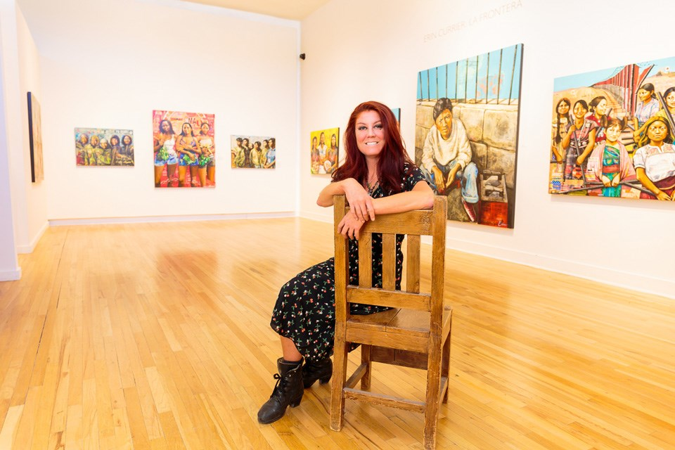 Woman sitting on wooden chair in art gallery