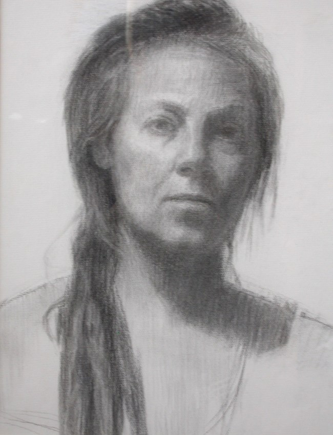 Charcoal self portrait of artist Lorraine Lans