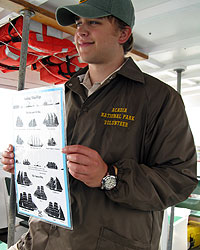 volunteer holding boat chart