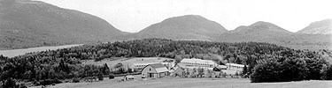 Civilian Conservation Corps camp with mountain backdrop