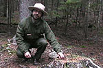 Ranger Neidig points out a red squirrel midden.