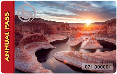 Color photo of the 2017 Interagency annual pass showing a river carving through desert sandstone at sunset.
