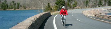Visitor biking on Otter Creek Causeway along Park Loop Road