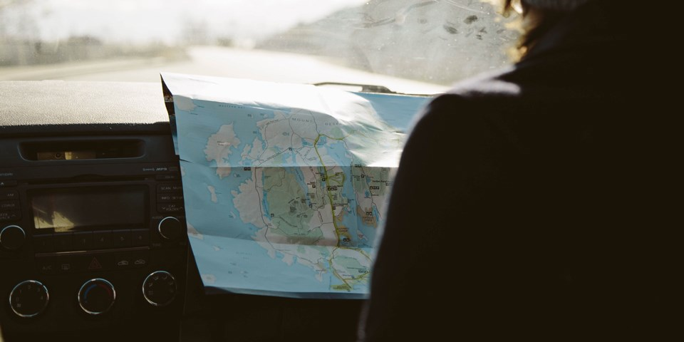 Visitor spreads park map across car dashboard