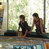 Two visitors explore the 3-D map of the island at the visitor center.