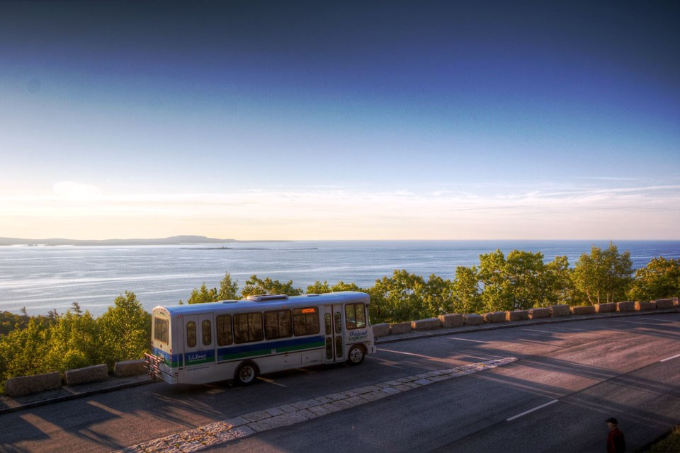 Island Explorer bus on Acadia coastline