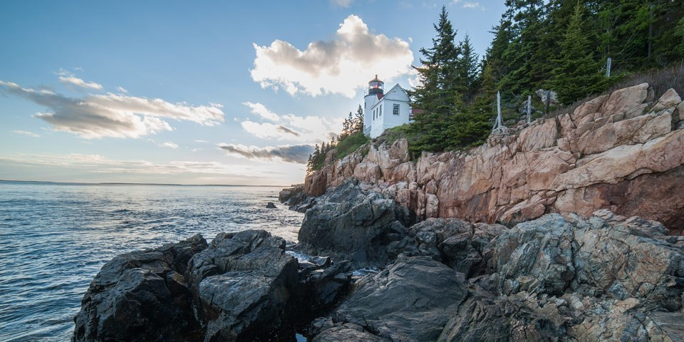 Lighthouse by rocky coastline