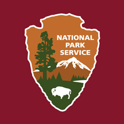 NPS arrowhead on a red background