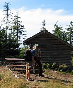 A park ranger meets with a visitor at a campsite on Isle au Haut.