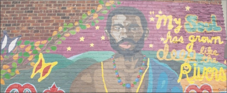 This image of Jan Rodrigues adorns a wall in Harlem