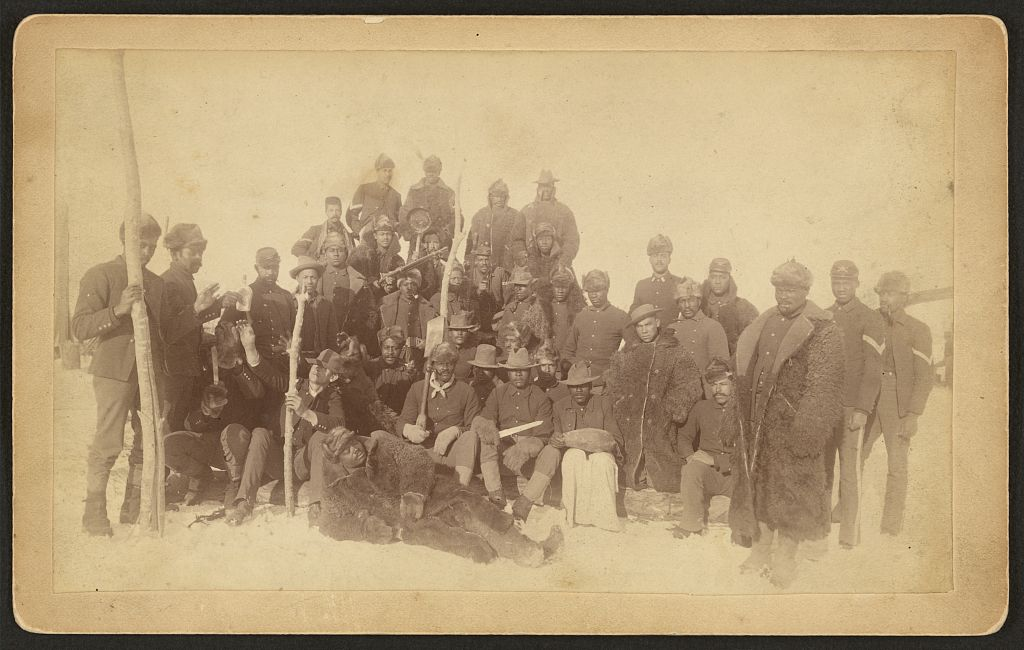 Buffalo soldiers of the 25th Infantry, some wearing buffalo robes. (Fort Keogh, Montana)