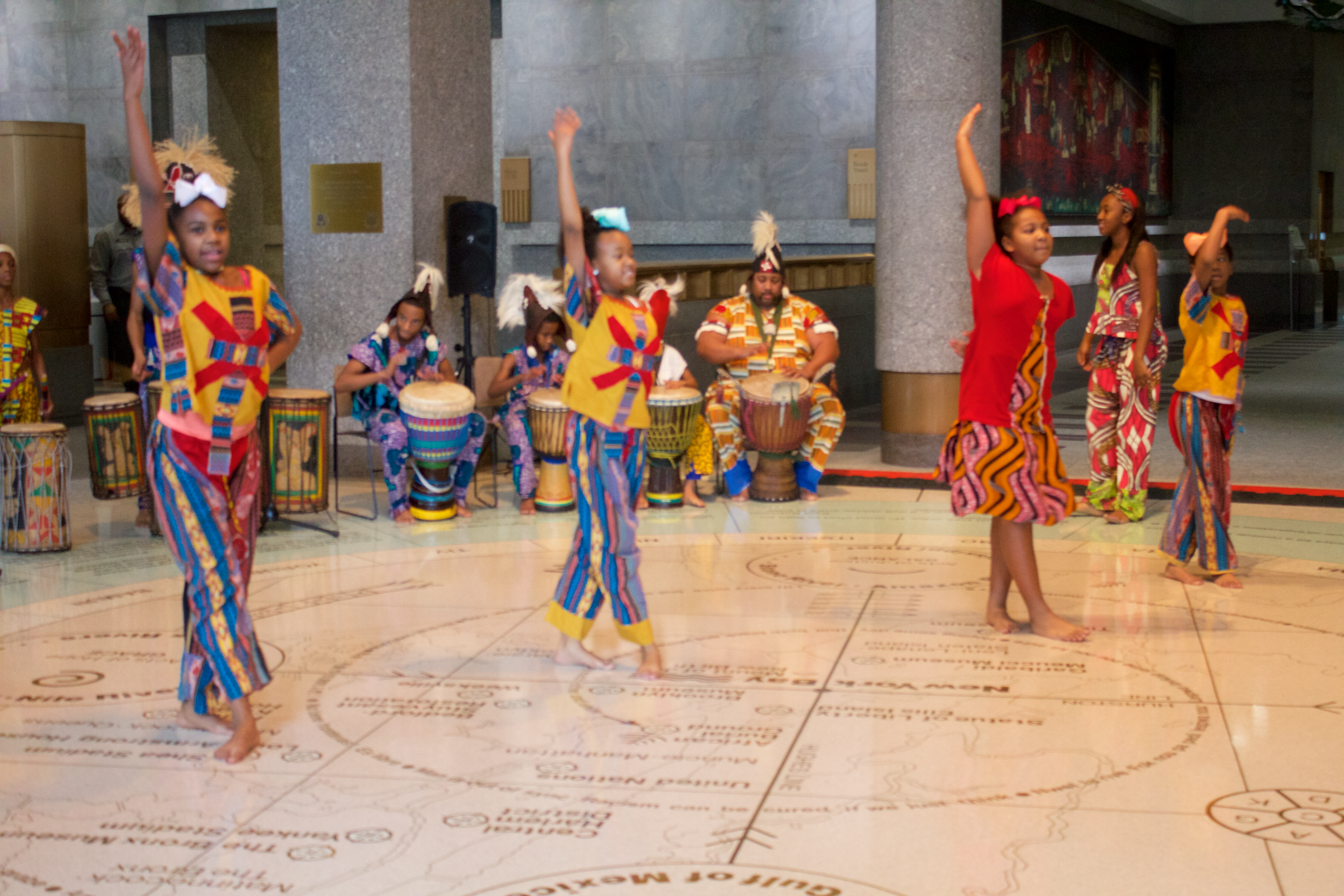 Performers dance in lobby