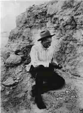 James Cook looking at a fossil.