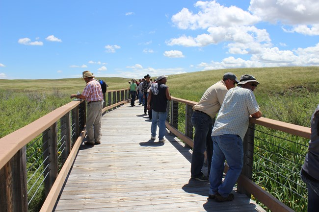 Group of visitors on Niobrara River Bridge.