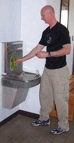 Filling a bottle at water bottle filling station.