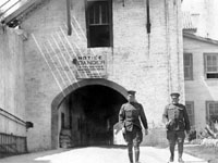 soldiers walking in front of concrete building