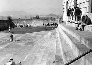 Inmates playing softball in the Alcatraz recreation yard.