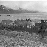 historic photo of American soldiers disembarking on a foggy beach
