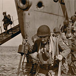 historic image of soldiers disembarking from a ship near shore