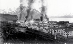 The Navy barracks in Dutch Harbor burn after they were struck by Japanese bombs on 4 June, 1942.