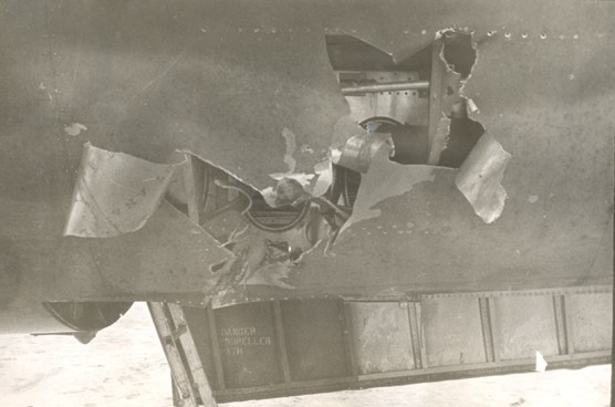 Large hole in the bottom of a B-26 bomber