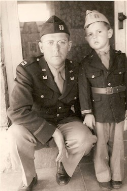 World War II-era image of uniformed Clifford McGinnis and his son