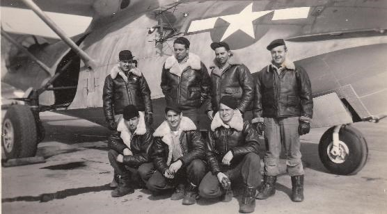 Crewmembers in front of their plane