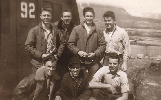 Crewmen in front of a Quonset hut on Attu