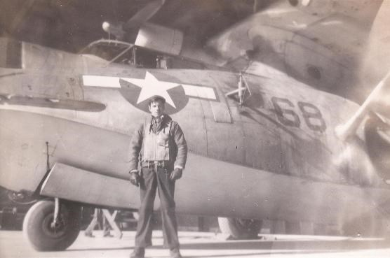 Crewman in front of his plane