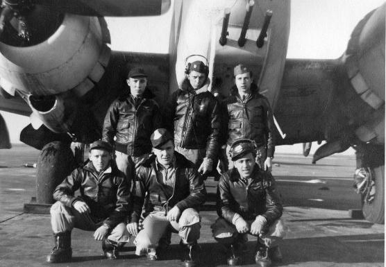 Men in front of a plane