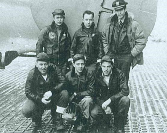 Crew posing by plane