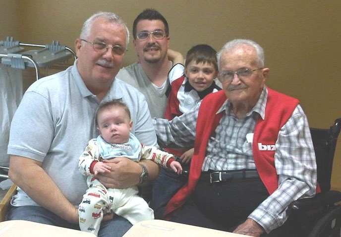 a baby, a young boy, and three men of varying generations