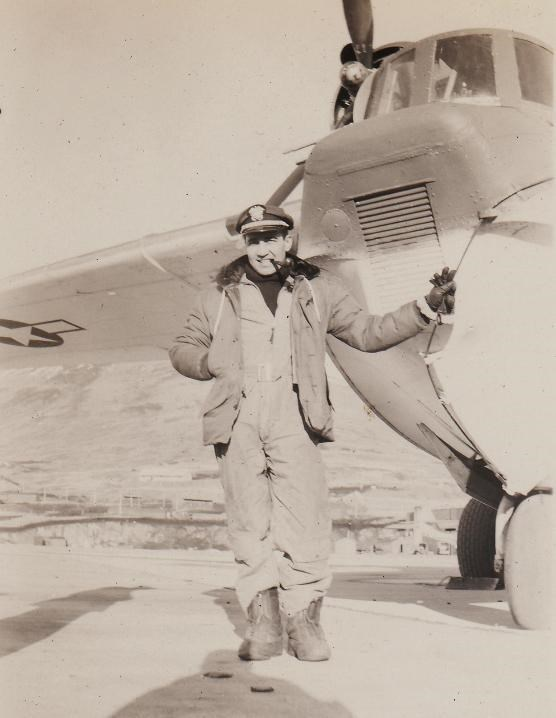Lt. Juliana standing next to his plane, at Dutch Harbor