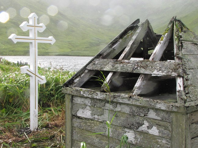 Small structure and Russian cross in rainy landscape