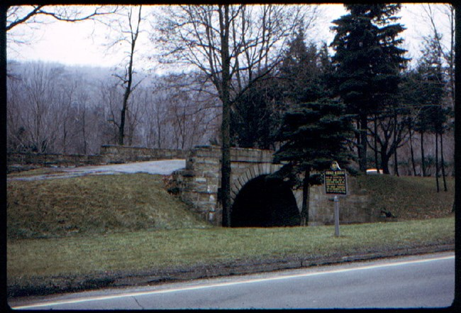 photo of the skew arch bridge tucked in its traffic island between lanes of 'old' 22
