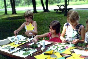 Children working on a craft project during a park program.