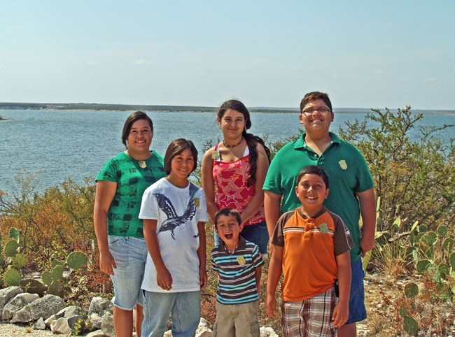 A group of Junior Rangers posing at Lake Amistad.