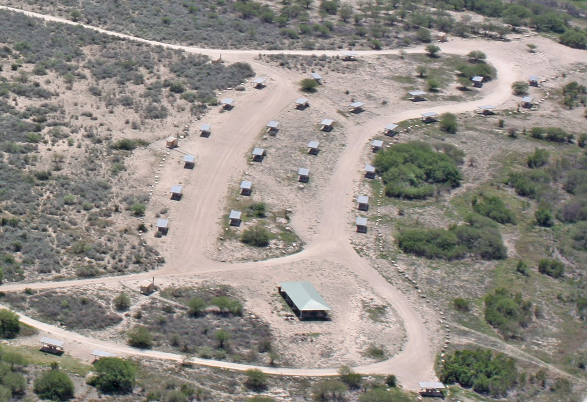 Aerial view of empty campground in desert setting.