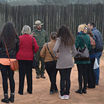 Park ranger talks with students at the prison site