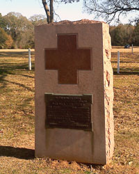 Stone monument featuring a red cross design