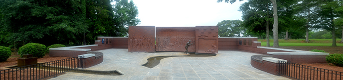Panoramic photograph of brick and metal sculptural feature