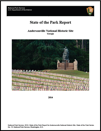Report Cover with image of monument, flags, and graves