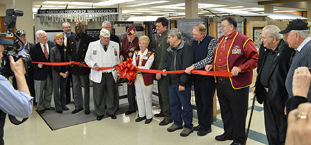 A group of people cut a ribbon