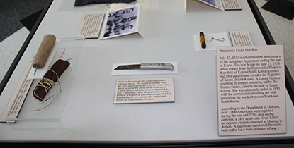 Artifacts and exhibit text inside a protective case