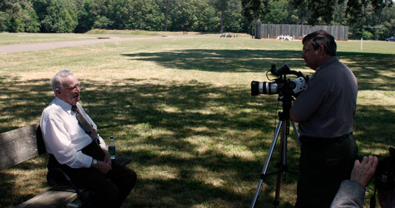 Park ranger interviewing old man at the site of the Andersonville prison