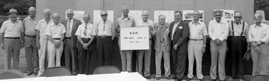 Men standing in front of presentation board.