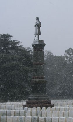 Falling snow coats a Civil War monument.